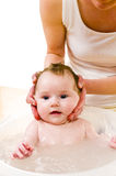 Mom bathing cute baby girl, close up Royalty Free Stock Photography