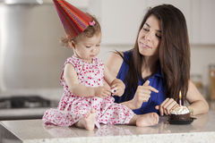 Mom and birthday girl having fun Royalty Free Stock Photos