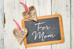 For Mom. Blackboard with hearts made of bark - For Mom Stock Photo