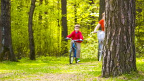 Mom and boy on bike stock footage