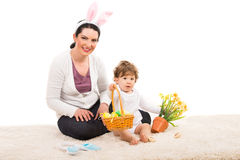 Mom and boy giving Easter basket Royalty Free Stock Image