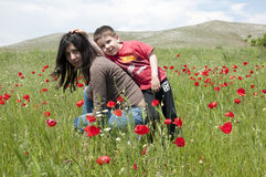Mom and boy on green meadow Royalty Free Stock Photo