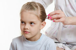 Mom braids hair six-year daughter Stock Photography