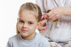 Mom braids tails daughter Royalty Free Stock Photo