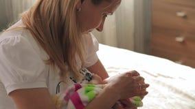 Mom breastfeeding her little daughter stock footage