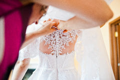 Mom buttons  of the bride dress Royalty Free Stock Photos