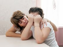 Mom calming   crying daughter. Mother   puting up with    daughter stock image