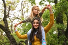 Mom care me on shoulders, Little girl. Lifestyle royalty free stock photography