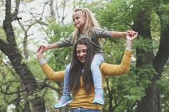 Mom care me on shoulders. Lifestyle stock photography