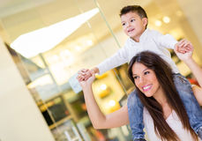 Mom carrying her son Stock Image