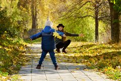 Mom catches running son. Autumn forest.  Stock Photography