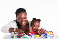 Mom and child. A little baby is playing with building block with her mother royalty free stock photos