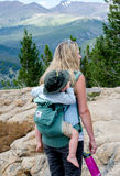 Mom and child backpacking in the rockies Royalty Free Stock Image