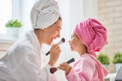 Mom and child are in bathrobes Royalty Free Stock Photo
