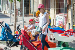 Mom with a child on a children`s attraction in the center of Pomorie, Bulgaria Stock Image