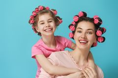 Mom and child doing hair Royalty Free Stock Image