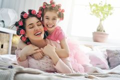 Mom and child doing hair Royalty Free Stock Images