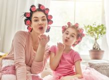 Mom and child doing makeup Stock Photos