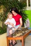 Mom and child girl on Crocodile farm in Phuket Royalty Free Stock Image