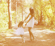 Mom and child having fun. Playing outdoors Royalty Free Stock Images
