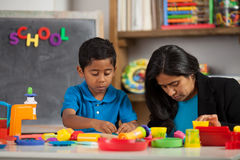 Mom and Child in Home School Setting Stock Photo