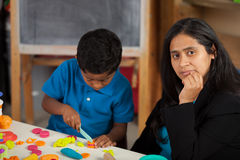 Mom and Child in Home School Setting Stock Image