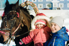 Mom, child and horse. In the winter outdoors stock photos