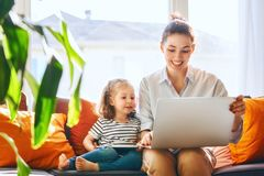 Mom and child with laptop Stock Photography