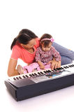 mom and child with piano Royalty Free Stock Image