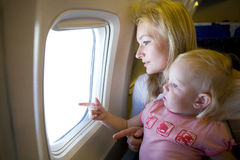 Mom and child in the plane Stock Image