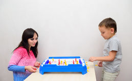 Mom with a child playing a board game Stock Photo