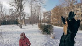 Mom and child playing snowballs stock footage