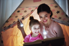 Mom and child are reading book Stock Image