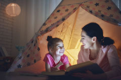 Mom and child are reading book Stock Images