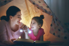 Mom and child reading a book Stock Photo