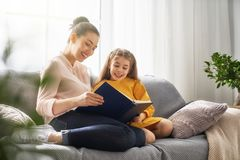 Mom and child reading a book Royalty Free Stock Photo