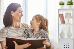 Mom and child reading a book Stock Photography