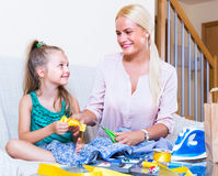 Mom and child with sew. Portrait of positive mom and child with sewing kit Stock Image