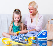 Mom and child with sew. Portrait of young mom and child with sewing kit Stock Image