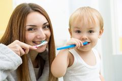Mom and child son brushing teeth in bathroom Royalty Free Stock Photography
