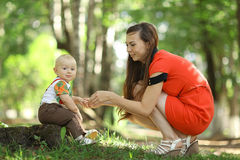 Mom with a child in  summer park Royalty Free Stock Images