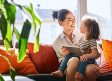 Mom and child with tablet Stock Photography