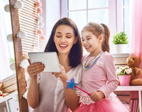 Mom and child with tablet Stock Images