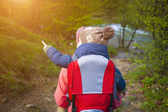 Mom and child traveling the world. Royalty Free Stock Images