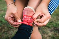 Mom child tying shoelaces Royalty Free Stock Photo