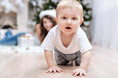 Mom with a child under the Christmas tree Stock Photography