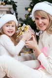 Mom with a child under the Christmas tree Stock Image
