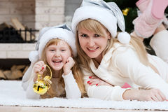 Mom with a child under the Christmas tree Royalty Free Stock Photos