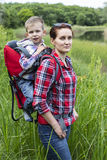 Mom with a child walking in the mountains. Stock Images