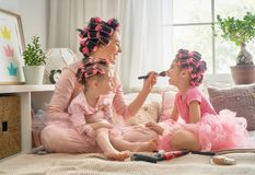 Mom and children doing makeup Royalty Free Stock Images
